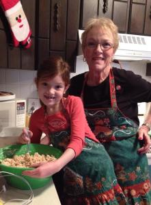 Grandma Karen and Casey wearing THOSE Christmas aprons while making holiday rice krispy treats!